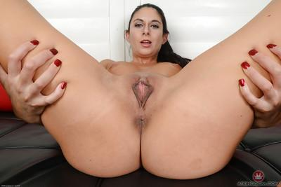 Brunette MILF Nikki Daniels stripping off yoga pants to spread bald cunt