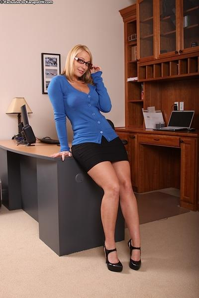 Stunning MILF in glasses getting rid of her clothes in her office