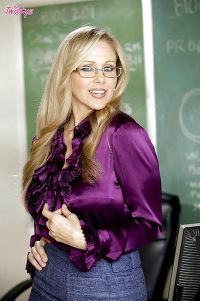 Seductive blonde teacher in glasses Julia Ann stripping in the class