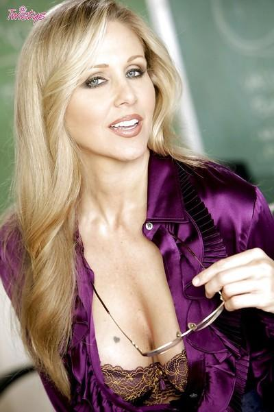 Seductive blonde teacher in glasses Julia Ann stripping in the class