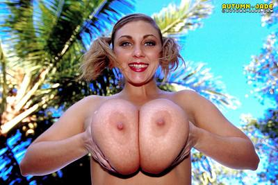 Solo girl Autumn Jade baring bald twat and huge MILF pornstar tits outdoors