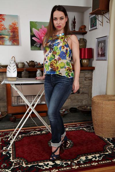 Euro mommy Olga Cabaeva removes clothing to model hairy vagina