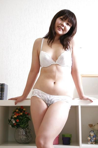 Chubby asian girl in lingerie and pantyhose undressing and vibing her slit