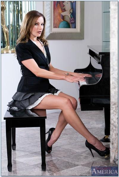 Stunning MILF teacher Samantha Ryan posing on the piano in heels