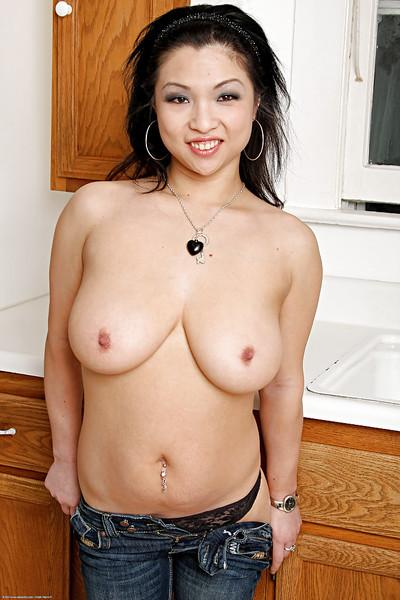 Busty Asian hooker Alexis Lee gets naked and plays with pussy