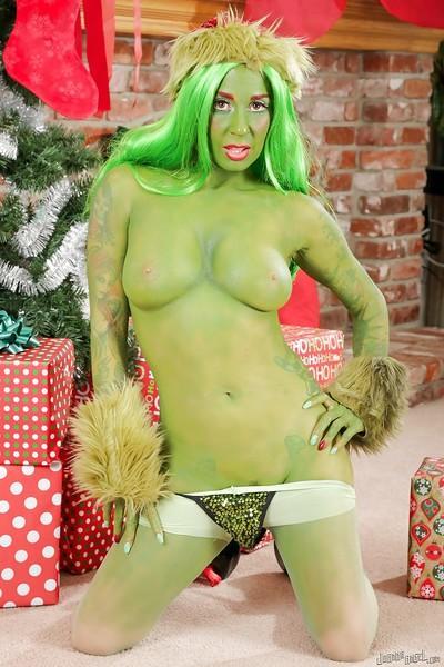 Green-skinned amateur Joanna Angel poses very hot on Christmas