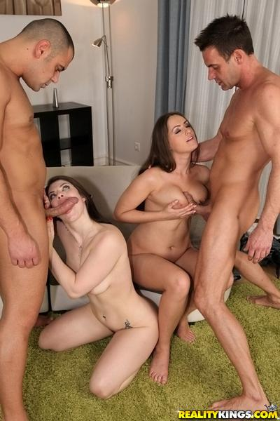 Kendra Love and Lucia Love go tongue on tongue while taking big cocks