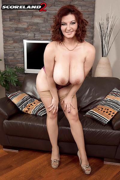 Redheaded stocking adorned MILF Vanessa Y flaunting massive juggs