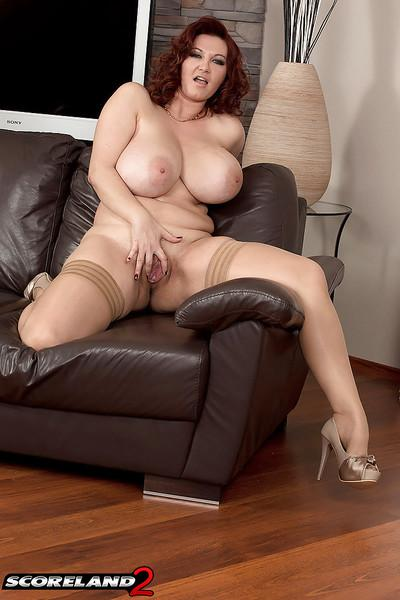 Redheaded stocking adorned MILF Vanessa Y flaunting massive juggs