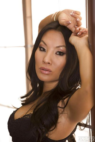 Hot Asian babe Asa Akira strutting fully clothed in skirt and high heels
