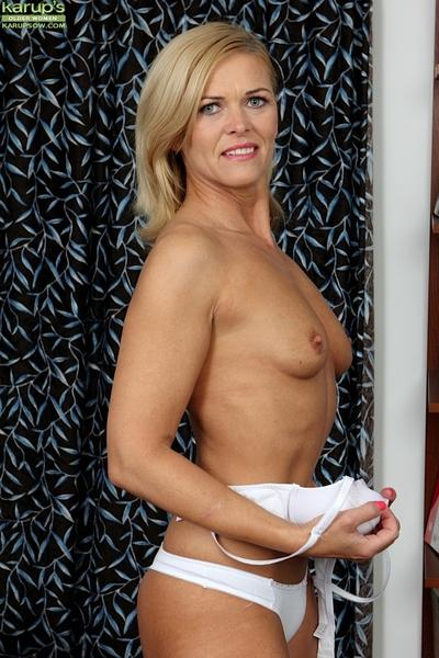 Close up posing in an office from an busty milf babe Carrie