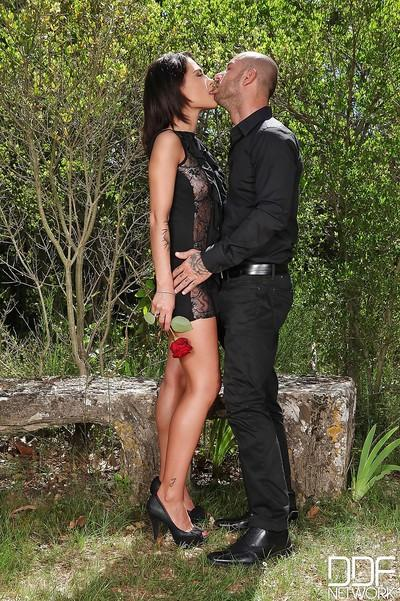 Clothed European milf Nikita Belluci is fucking with her man outdoor