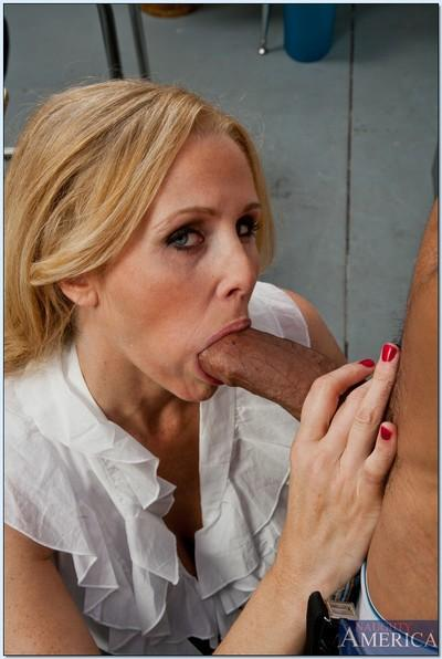 Seductive busty MILF Julia Ann sucks and fucks a big black boner