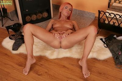 Sensual milf with red hair Klarisa Hot is lying naked on the floor