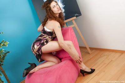 Seductive MILF on high heels exposing her petite tits and shaggy cunt