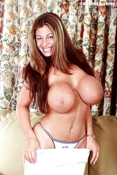 MILF babe model Crystal Gunns displaying huge boobs while spreading beaver