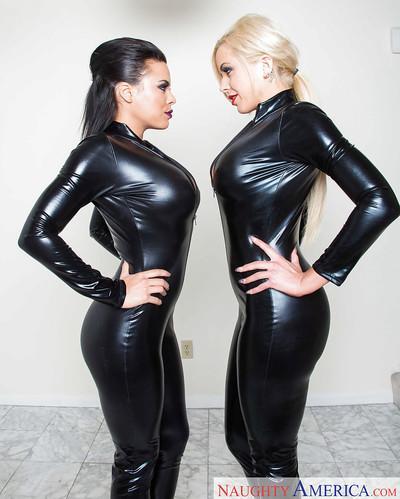 Latex lesbians Luna Star and Nina Elle posing in latex bodysuits