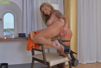 Busty blonde MILF solo girl in high heels flaunts phat ass and sexy legs