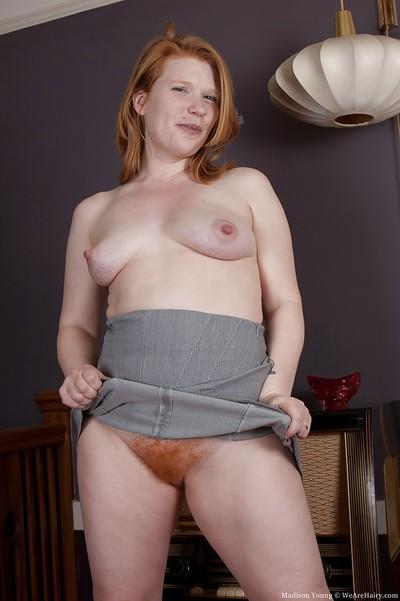 Redhead babe with big tits Madison Young stripping and spreading her legs