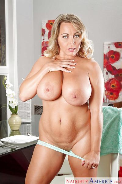 Cougar Milf Amber Lynn Bach unleashing her massively huge tits