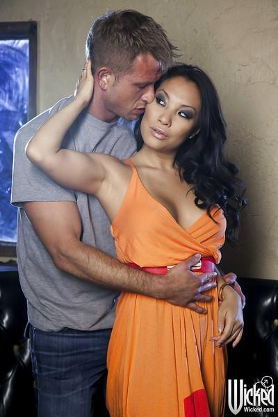 Busty asian MILF Asa Akira gives a blowjob and gets nailed hardcore