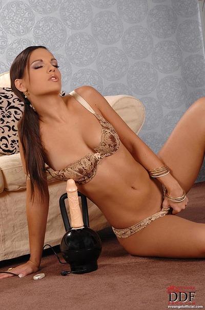 Hot MILF pornstar Eve Angel strips to masturbate her slit