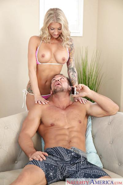 Tattooed blonde MILF wife Synthia Fixx giving blowjob in 69 sex position