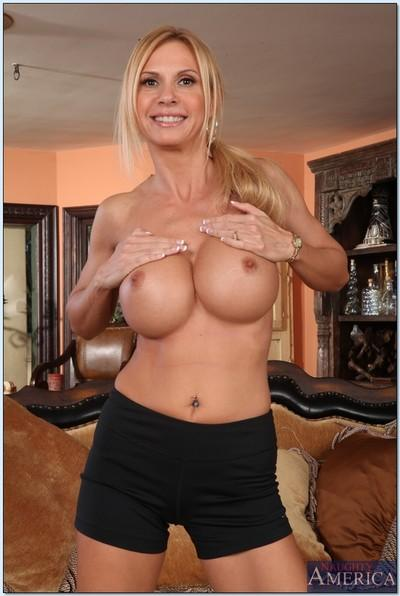 Sporty MILF Brooke Tyler exposing her huge boobs and shaved cooter