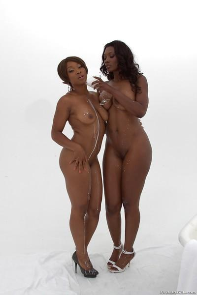 Bootylicious ebony MILFs Nyomi Banxxx & Imani Rose playing in milk bath