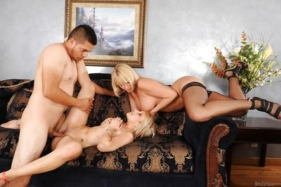 Lecherous mom sharing a thick boner with her slutty step daughter