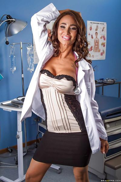 Frisky doctor revealing her round boobies and hot ass in her office