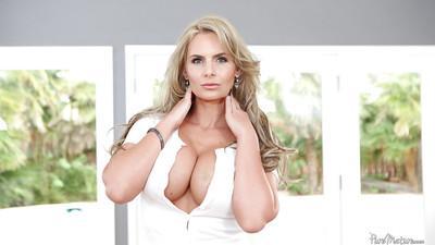 Big tits milf Phoenix Marie reveals her tight ass in panties