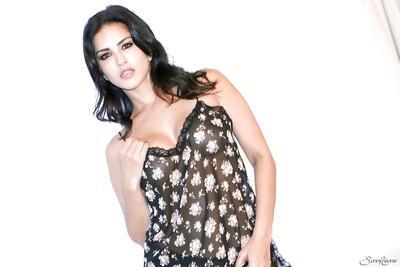 Milf brunette Sunny Leone is posing pretty elegant in her lingerie