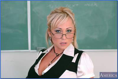 Puffy MILF teacher in glasses strips to black stockings and spreading