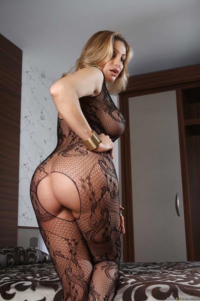 Elegant blonde with big tits Vittoria Risi takes off sexy pantyhose