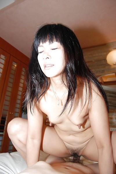 Gracious Asian milf Yumiko Takase gets sweaty during hardcore fucking
