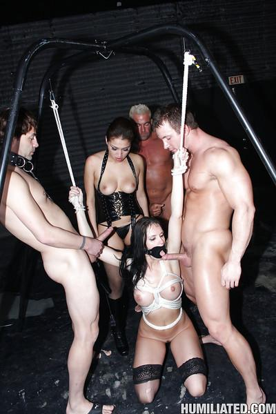 MILF babe Jennifer Dark gets into hardcore BDSM fuck with bukakke