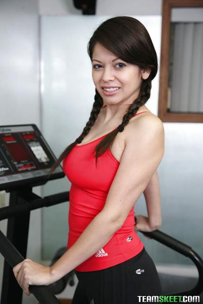 Sporty latina with pigtails Evie Dellatossa stripping in the gym
