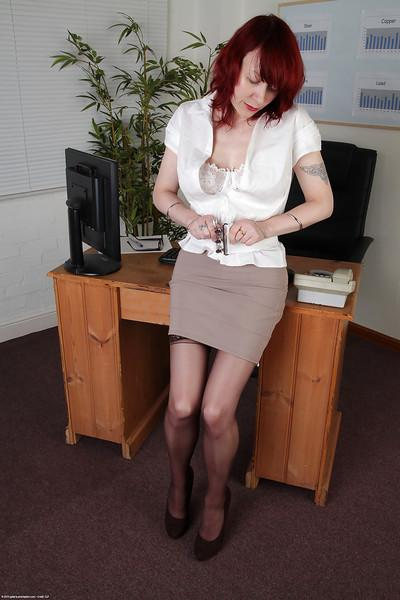 Creative milf Scarlet Rose shows her lovely lacy lingerie in office