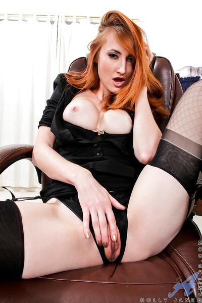 Redhead MILF in stockings Holly Jane uncovering her big tits and pussy
