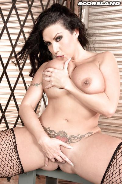 Tattooed MILF babe Sheridan Love exposing nice melons and pierced nipples
