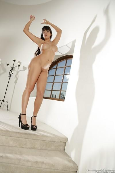Leggy Latina mom Mercedes Carrera modeling fully clothed in dress and heels