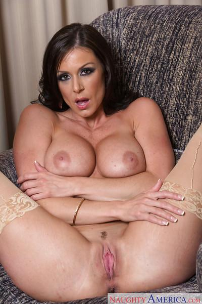 Amateur babe Kendra Lust posing her legs in stockings and high heels