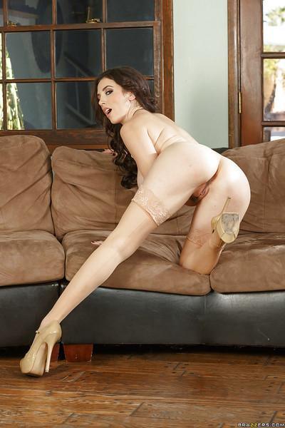 Milf babe Jelena Jensen posing in black stockings and garters