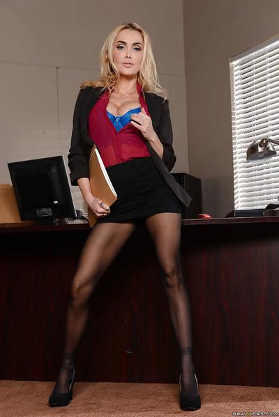 Blonde busty office MILF Devon showing off her legs in stockings