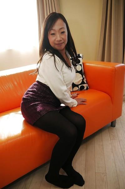 Age Asian lady Yakako Miyai spreading hairy Japanese pussy