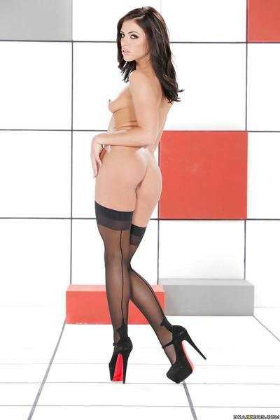 Outstanding black-haired milf Adriana Chechik poses in the white room