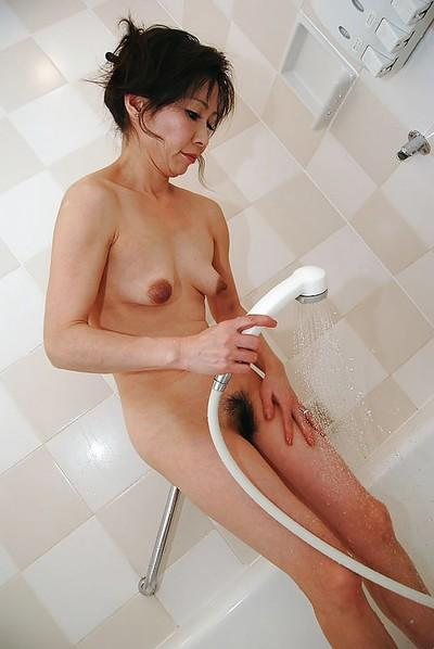 Asian MILF with hairy twat and tiny tits Mayumi Miyazaki taking shower