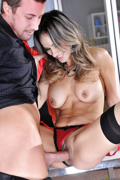 Latina Milf Nadia Styles exposing her big breasts and ass at work
