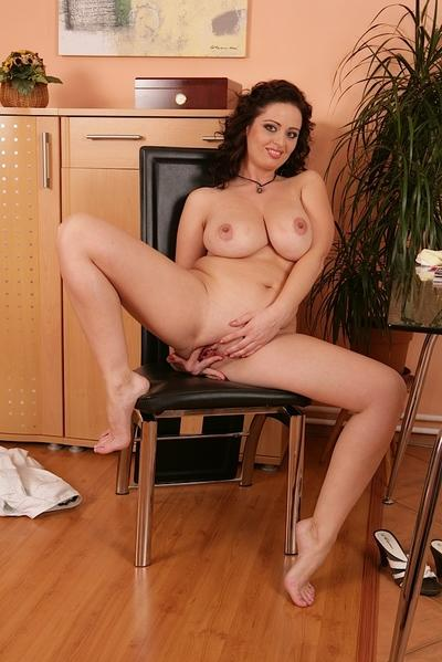 Brunette Milf Sirale spreading her legs and her shaved wet pussy
